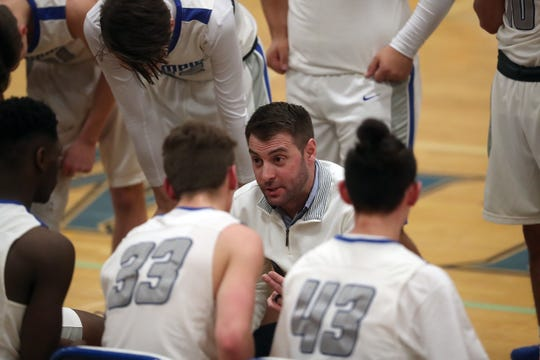 Olympic boys basketball coach Jon O'Connor and the Trojans went 7-2 over the team's final nine games to secure a district playoff berth.