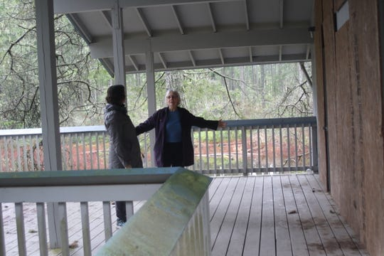 Kitsap County Commissioner Charlotte Garrido, right, shows off Camp Calvinwood's community lodge to Kirsten Jewell, left, Kitsap's housing and homeless manager.