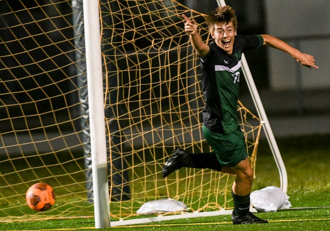 Melbourne's Aden O'Hara (10) celebrates a goal during the District 12-6A district soccer semifinal against South Fork.