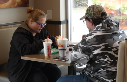 Sara and Kenneth Cress have lunch in the dining room of the newly opened Burger King on East Mansfield Street on Wednesday.
