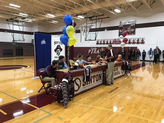 Sinton's Jackson Allen and Marcus Villarreal prepare to sign national letters of intent to play college athletics on Wednesday, Feb. 5, 2020 at Sinton High School.