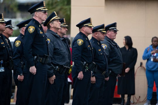 Corpus Christi Police Department command staff wait outside department headquarters before a procession for fallen officer Alan McCollum on Wednesday, Feb. 5, 2020. McCollum, 46, was killed during a traffic stop on Jan. 31, 2020.