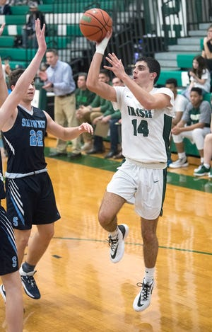 Camden Catholic's Lucas Dunn puts up a shot during the boys basketball game between Camden Catholic and Shawnee played at Camden Catholic High School on Tuesday, February 4, 2020.