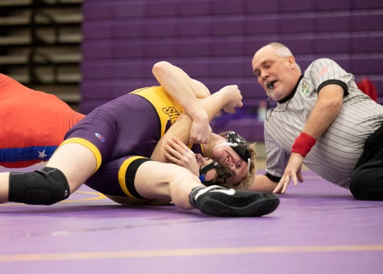 Unioto's Matt Griffin pinned Zane Trace's Lane Stewart in a 152-pound match during senior night at Unioto High School on Feb. 4, 2020, in Chillicothe, Ohio.