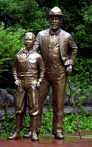 """A statue of Daniel Carter Beard (right), """"Father of the Boy Scouts,"""" on Third Street, Covington."""