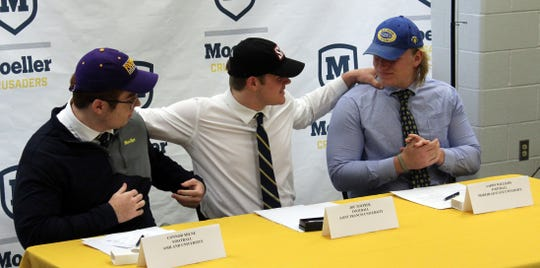 Moeller High School athletes signed their letters of intent to play college football Wednesday, Feb. 5. They are, from left: Connor Milne, Ashland University; Joe Toepfer, Saint Francis University; Aaron Williams, Morehead State University.