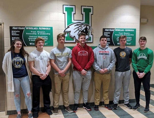 Harrison High School athletes signed their letters of intent to play college sports Feb. 5. They are, from left: Grace Young, Mount St. Joseph University volleyball and softball; Levi Tidwell, Indiana Wesleyan University football; Josh Ridings, Mount St. Joseph University football; Connor Kinnett, University of Indianapolis football; Dylan Stocker, Concordia University football; CJ Young, Marian University football; Micah Childs, Frontier Community College baseball.