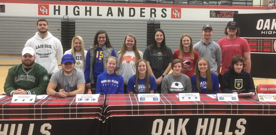 Oak Hills athletes who signed letters of intent to play college sports Feb. 5 were, from left: Front - DJ Shaw (Lake Erie College football), Sebastain Bachler (Hocking College football), Cailee Plunkett (Hanover College cross country & track and field), Grace Armentrout (Thomas More University women's soccer), Molly Ewry (Shawnee State University soccer), Isabel Dragotta (Thomas More University soccer), Rosalie Pictor (Mount St. Joseph University tennis); back - Ryan Huellemeier (Lake Erie College football), Kayla Roddy (Thiel College softball), Josie Wefer (Morehead State University softball), Emma Bode (University of Findlay softball), Rachel Winkler (Mount St. Joseph University lacrosse), Brianna Schneider (University of Cincinnati Clermont volleyball), Joey Siegel (Mount St. Joseph University golf), Michael Hehman (University of the Cumberlands lacrosse).