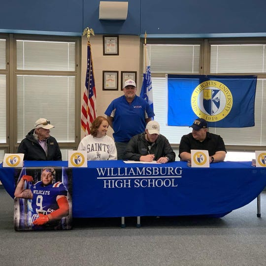 Surrounded by his family, Jarrett Thatcher of Williamsburg signed his letter of intent to play college football at Siena Heights University in Adrian, Michigan.