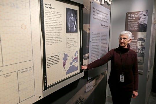 Cheryl Hecht, 70, pulls up a display of her father, Holocaust survivor David Hochstein, at the Holocaust & Humanity Center inside the Cincinnati Museum Center on Wednesday, Feb. 5, 2020.
