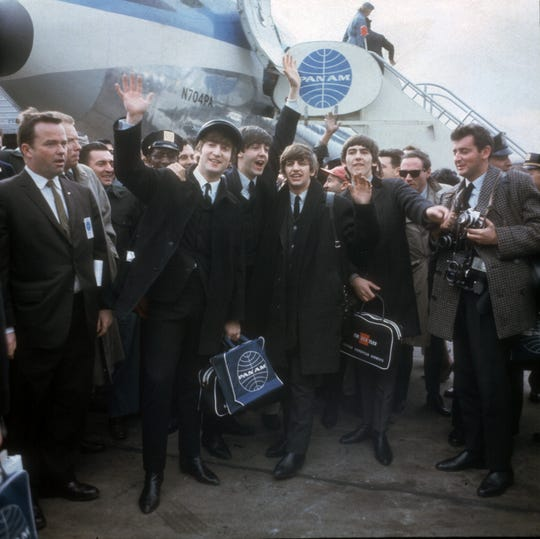 The Beatles arrive at New York's Kennedy Airport Feb. 7, 1964 for their first U.S. appearance. From left are: John Lennon, Paul McCartney, Ringo Starr and George Harrison.