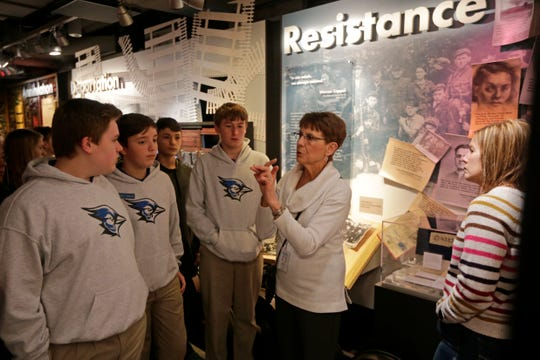 Gallery guide Pat Hopson leads a class of eighth graders from St. Jospeh School at the Holocaust & Humanity Center inside the Cincinnati Museum Center in Cincinnati on Wednesday, Feb. 5, 2020.