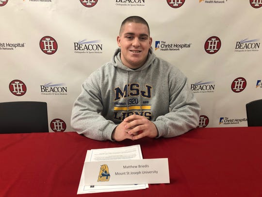 Matthew Briedis of Indian Hill High School signed to play football and run track for Mount St. Joseph University Feb. 5.