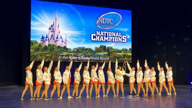 Seton High School dancers pose as national champions after winning a hip hop title in the 2020 UDA Varsity National Competition.