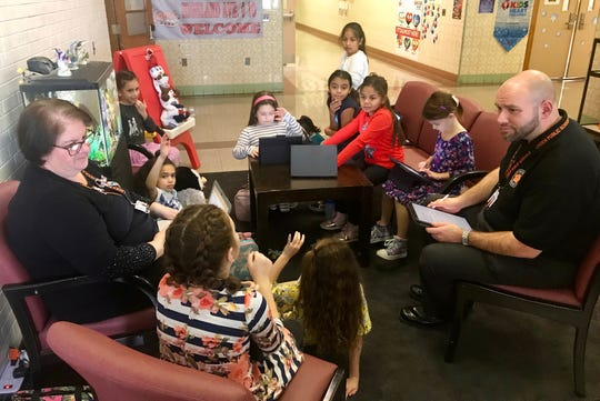 Third-graders meeting with Principal David Walker to make plans for the Save the Turtles dance at School No. 10 in Linden.