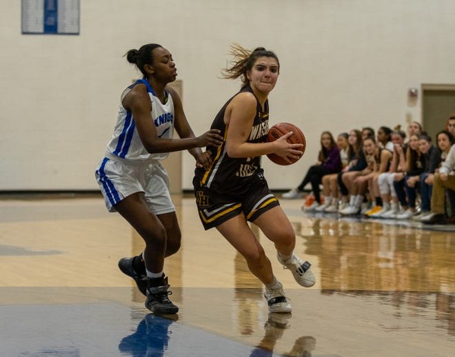 Caileigh Walsh led the way with 21 points and 13 rebounds to guide the Knights over the Warriors in a Skyland Delaware meeting.