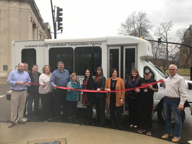 Local officials and representatives of the Coshocton County Coordinated Transportation Agency recently cut a ribbon to commemorate a shuttle devoted to a new public service route targeted at low income individuals who need rides to basic locations like stores and pharmacies in the county.