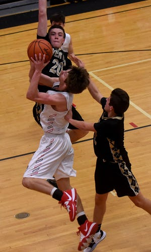 River View's Zach Balo, left, and Drew Ireland play defense on Coshocton's Gaven Williams during a game last season at The Wigwam. Both players return to a core of eight seniors the Black Bears will feature this season.