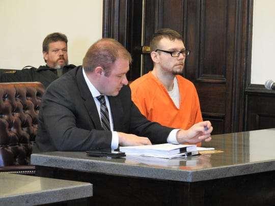 Attorney Zachuary Meranda reviews notes while speaking on behalf of his client, Kevin Bradford, in Coshocton County Common Pleas Court. Bradford received a minimum sentence of three years for one count of arson, a third-degree felony.