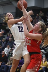 Indianola junior Kendall Clatt collides with Dallas Center-Grimes junior Lexi Protzman on her way to the basket. Indianola hosted Dallas Center-Grimes on Feb. 4, losing the Little Hawkeye Conference game 60-44.