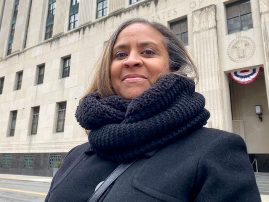 Melisa Ingram, 50, of Southfield, outside the federal courthouse in Detroit after filing a lawsuit against Wayne County that accuses sheriff's deputies of wrongly seizing her car.