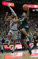 Michigan State's Cassius Winston scores against Penn State's Curtis Jones in the second half Tuesday, Feb. 4, 2020 at the Breslin Center.
