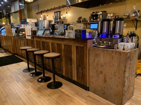 Reclaimed woods was used throughout Proving Grounds Coffee in Royal Oak.