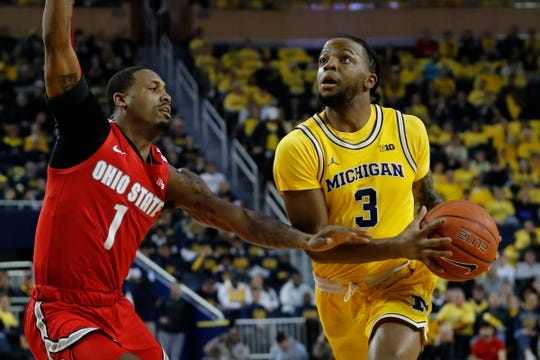 Michigan guard Zavier Simpson dribbles against Ohio State guard Luther Muhammad in the first half Tuesday, Feb. 4, 2020, at Crisler Center.