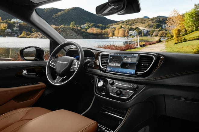 The interiorÊof theÊ2021 Chrysler Pacifica Pinnacle model includes a new integrated Ultra console, the all-new Uconnect 5 systemÊwith a 10.1-inch touchscreen thatÊdelivers the largest standard touchscreen in its classÊand new accent points, including Caramel Nappa leather seats and aÊMid-century Timber Hydro bezel.