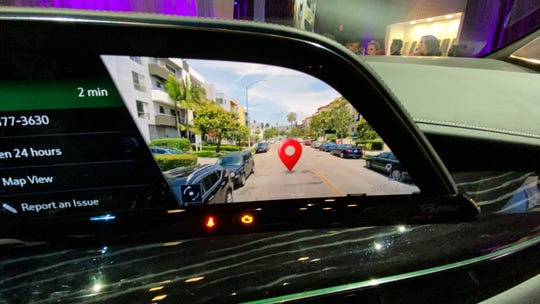 Augmented reality marks a destination in 2021 Cadillac Escalade's navigation system.