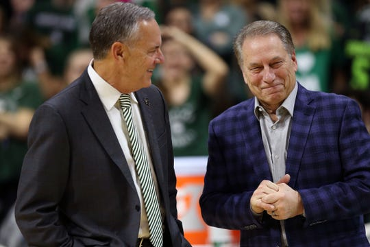 Michigan State coach Tom Izzo (right) and retiring Michigan State football coach Mark Dantonio talk prior to MSU's 75-70 loss on Tuesday, Feb. 4, 2020, in East Lansing.