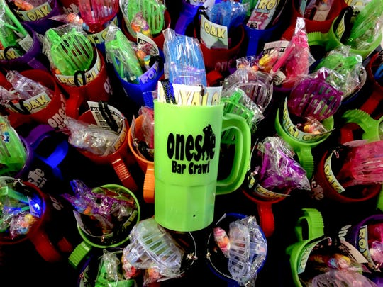 The plastic mugs filled with light up binkies, candy necklaces and sunglasses were given out to people during the fourth annual Onesie Bar Crawl at various bars in Royal Oak, Michigan on Saturday, Jan. 25, 2020.