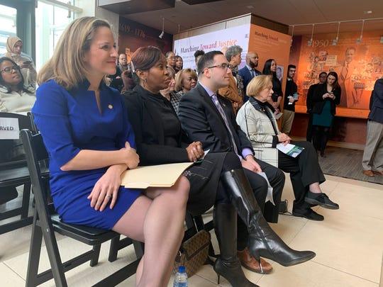 Secretary of State Jocelyn Benson, Detroit City Clerk Janice Winfrey, Wayne State Student Senate President Stuart Baum and BOG Chair Marilyn Kelly sitting in the front row while waiting to speak.