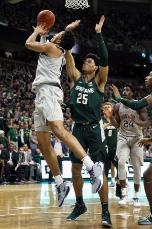 Penn State's Lamar Stevens lays the ball up against Michigan State's Malik Hall during the first half at the Breslin Center, Feb. 4, 2020.