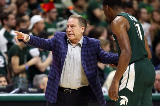 Tom Izzo talks to forward Aaron Henry during the first half at the Breslin Center on Tuesday.