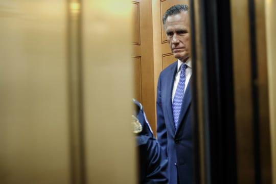 Michigan native Sen. Mitt Romney of Utah takes an elevator to the Senate floor in the U.S. Capitol in Washington, DC on Feb. 5, 2020.