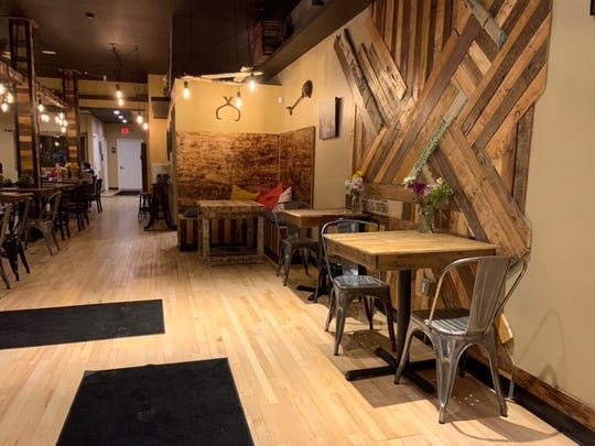 Reclaimed wood is featured on the walls inside Proving Grounds Coffee in Royal Oak.