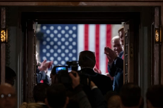 President Donald Trump enters the House floor where he will give his State of the Union address to a joint session of Congress in the House Chamber on Capitol Hill in Washington, Tuesday, Feb. 4, 2020.