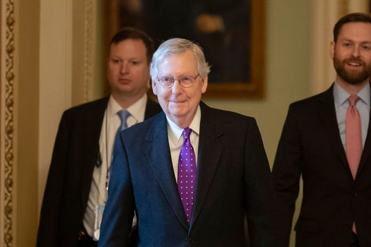 Senate Majority Leader Mitch McConnell of Ky., second from left, walks from the Senate Floor on Capitol Hill, Tuesday, Feb. 4, 2020 in Washington.
