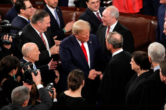 President Donald Trump greets Chief Justice of the United States John Roberts as he arrives to deliver his State of the Union address to a joint session of Congress on Capitol Hill in Washington, Tuesday, Feb. 4, 2020.