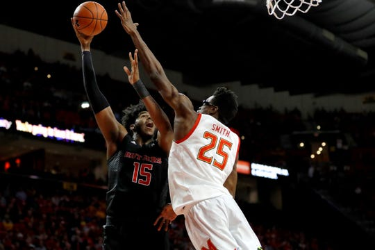 Rutgers center Myles Johnson (15) goes up for a shot against Maryland forward Jalen Smith during the first half Tuesday.