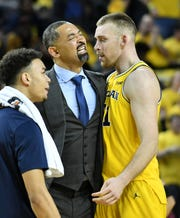 Michigan center Austin Davis (right) scored 11 off the bench in Tuesday night's loss to Ohio State.