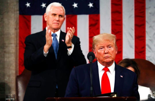 President Donald Trump delivers his State of the Union address to a joint session of Congress in the House Chamber on Capitol Hill in Washington, Tuesday, Feb. 4, 2020, as Vice President Mike Pence applauds.