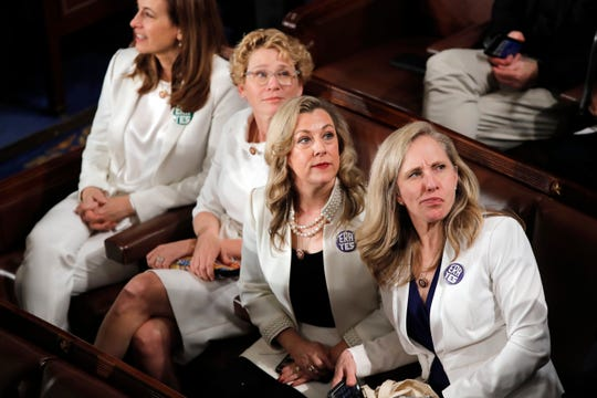 Rep. Abigail Spanberger, D-Va., right, and others wait for President Donald Trump to deliver his State of the Union address to a joint session of Congress on Capitol Hill in Washington, Tuesday, Feb. 4, 2020.