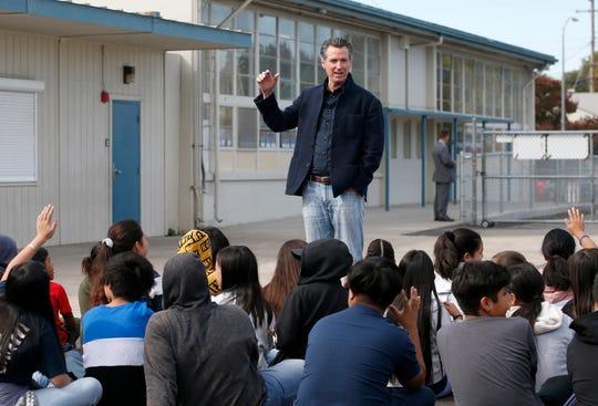 California Gov. Gavin Newsom talking to students during his visit to the Ethel I. Baker Elementary School in Sacramento, Calif. on Oct. 7, 2019.