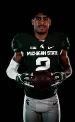 Jordon Simmons, a running back from Georgia, is holding off on signing with Michigan State following the retirement of head coach Mark Dantonio.