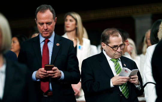House Impeachment Manager Rep. Adam Schiff, D-Calif., left, types on a device, as House Impeachment Manager and Judiciary Committee Chairman Rep. Jerrold Nadler, D-N.Y., right, reads a pocket copy of the U.S. Constitution as they wait for President Donald Trump to arrive and deliver his State of the Union address to a joint session of Congress in the House Chamber on Capitol Hill in Washington, Tuesday, Feb. 4, 2020.