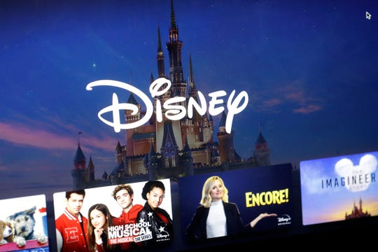 a Disney logo forms part of a menu for the Disney Plus movie and entertainment streaming service on a computer screen in Walpole, Mass., Wednesday, Nov. 13, 2019.