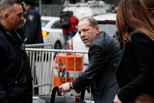 Harvey Weinstein, center, departs a Manhattan courthouse for his rape trial, Wednesday, Feb. 5, 2020, in New York.