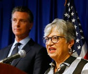 California Air Resources Board Chair Mary Nichols, flanked by Gov. Gavin Newsom, left, discusses the Trump administration's pledge to revoke California's authority to set vehicle emissions standards that are different than the federal standards, during a news conference in Sacramento, Calif., Wednesday, Sept. 18, 2019.